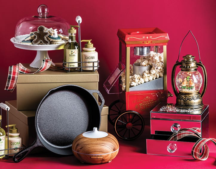 cake display, cast iron frypan, popcorn maker, mirrored jewellery box, essential oil diffuser on a red background