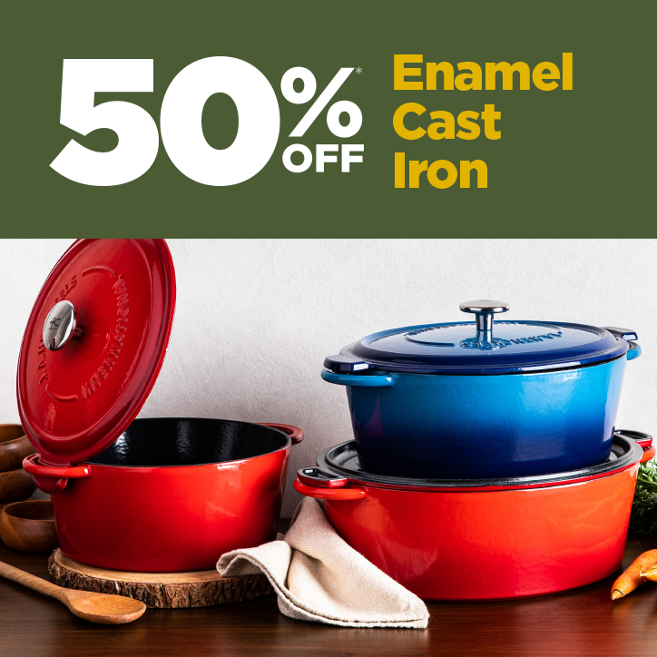 blue and red enamel cast iron dutch ovens on a wooden tabletop