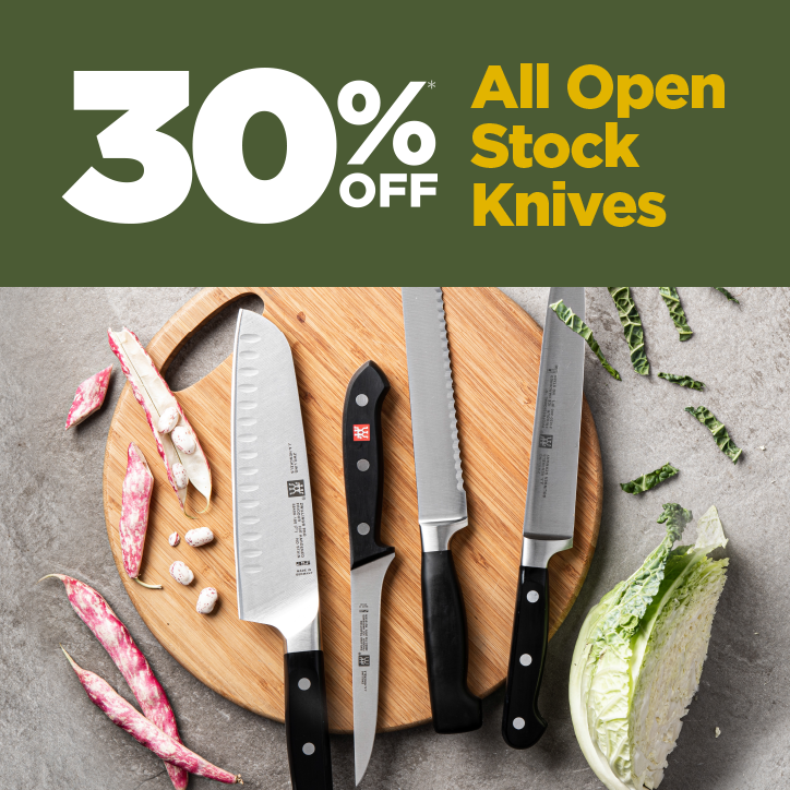 30% Off Open Stock Knives - various knives on a round cutting board