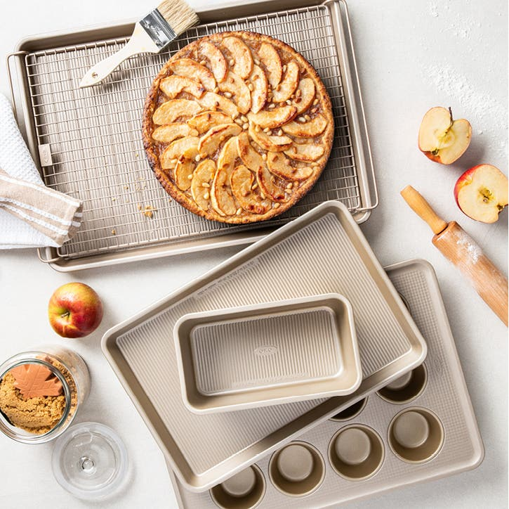 baking sheets, tray, muffin pans, and baking utensils on a countertop