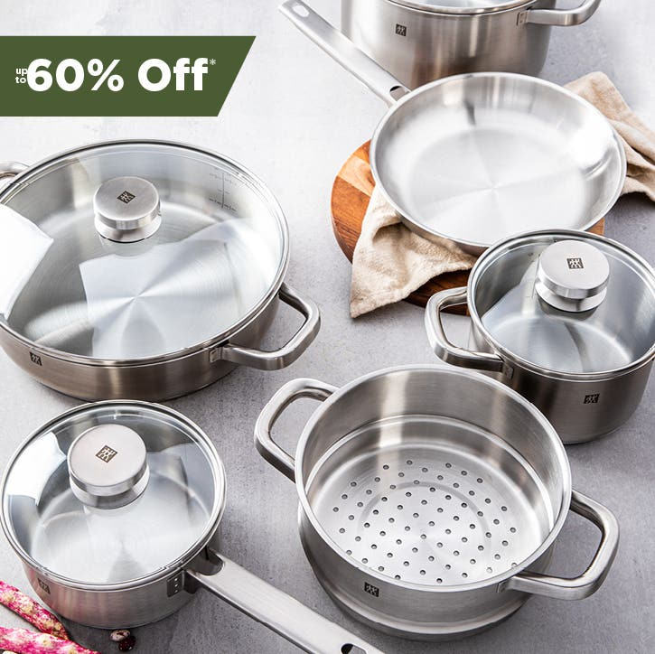 5 pieces of open stock cookware on a slate countertop