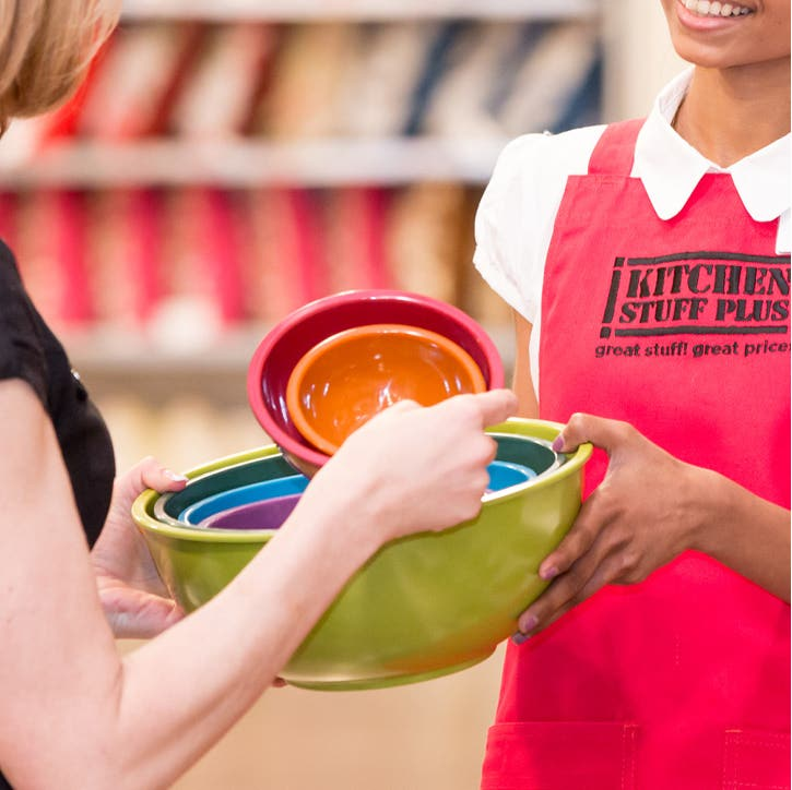 a customer and Sales Associate holding brightly coloured mixing bowls