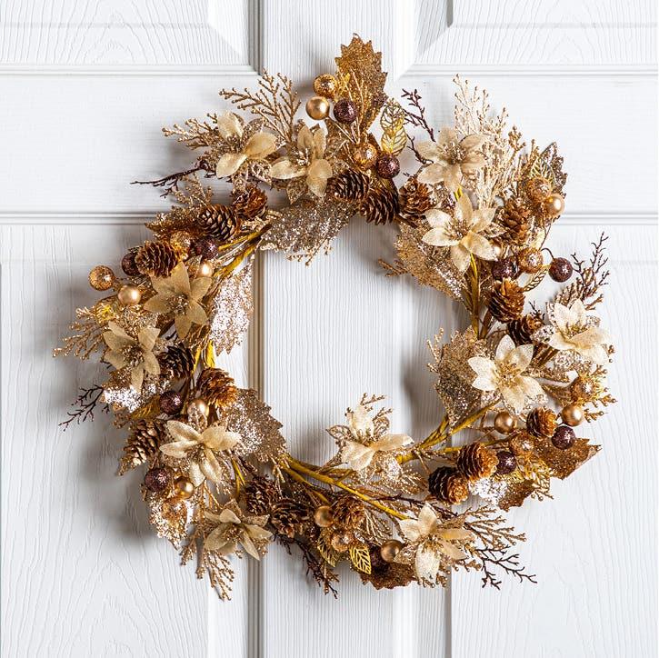 golden wreath on a white door