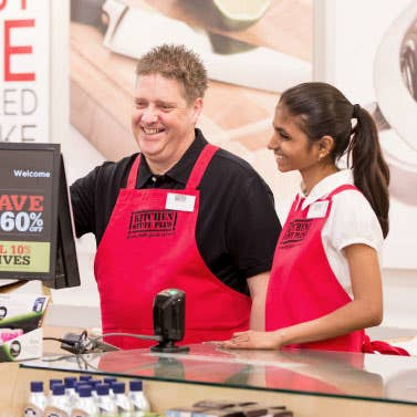 Store Manager and Sales Associate at the cash register